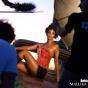 wmb-mallika-sherawat-nick-saglimbeni-desert-truck-sitting-shorts-over-shoulder