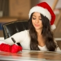 melanie-iglesias-santa-christmas-hat-red-gloves-signing-slickforce-lifesize-posters-saglimbeni-2