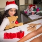 melanie-iglesias-santa-christmas-hat-red-gloves-signing-slickforce-lifesize-posters-saglimbeni